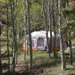 Tent camper at Aspen Acres Campground in Rye Colorado