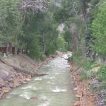 Shady sites next to the river in Ouray, Colorado at 4j+1+1 RV Park and Campground