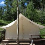 Glamping safari outfitters tent at Aspen Acres Campground in Rye CO