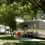 Dolores River Campground in Dolores Colorado offers RV sites, tent camping, vacation cabin rentals, rental vintage RVs, glamping yurts, and glamping covered wagons