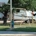 Kids swinging at Falcon Meadow RV Campground near Colorado Springs