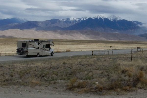 RV with Great Sand Dunes National Park in the background, near Alamosa CO
