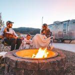 A family at an RV site at River Run RV Resort in Granby Colorado