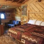 Interior bedroom of a cabin - The Lodge at San Isabel in Rye Colorado offers your vacation rental cabins