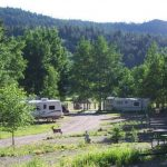 Choose RV sites tucked into the mountain or close to the rec hall at Aspen Acres Campground in Rye Colorado