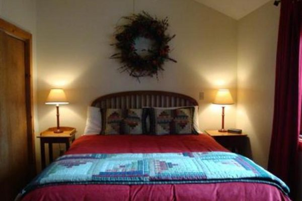 Spruce A bedroom Lodging at Bristlecone Lodge in Woodland Park, Colorado