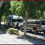 Back-in water and electric sites RV campsites available at Cedar Creek RV Park (Montrose CO)