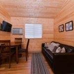 Dining and family room area in our 2-bedroom cabin (sofa folds out to sleep 2) at Gunnison Lakeside RV Park and Cabins in Color