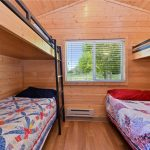 Oversize double and 3 twins in 2-bedroom cabin at Gunnison Lakeside RV Park and Cabins in Colorado