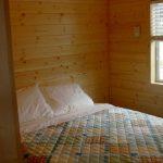 Queen bedroom in 2-bedroom cabin at Gunnison Lakeside RV Park and Cabins in Colorado