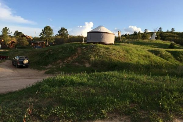 A yurt and teepee at Jellystone Park at Larkspur (Larkspur Colorado)