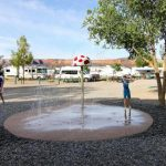 Splash pad water feature is a unique way to cool off and feel like a kid again! ~ Junction West RV Park (Grand Junction Colora